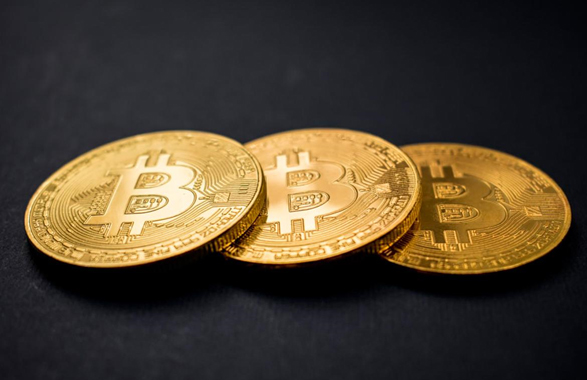 a close up rendering three bitcoins